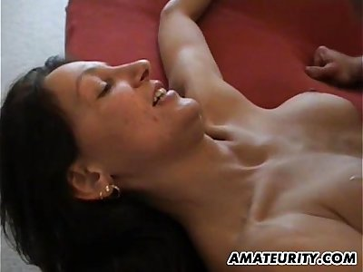 Amateur mother with big tits in action on her bed