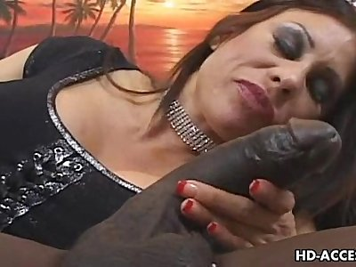 Mature MILF takes on immense black cock
