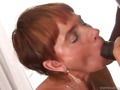 redhead mature takes a pounding from a big black cock