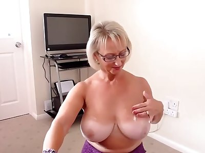 busty granny (best tit ever!) gives a hj